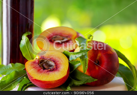 Peaches and bottle of liquor stock photo, Peaches and bottle of liquor by Inacio Pires