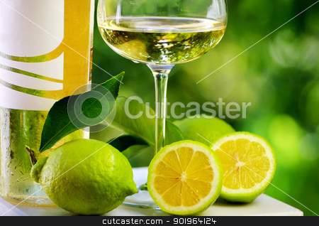 White wine and green lemons. stock photo, White wine and green lemons. by Inacio Pires