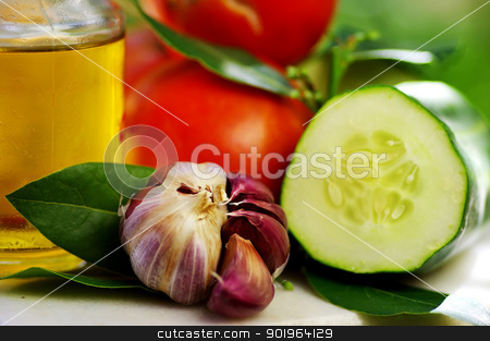 Olive oil and vegetables stock photo, Olive oil and vegetables by Inacio Pires