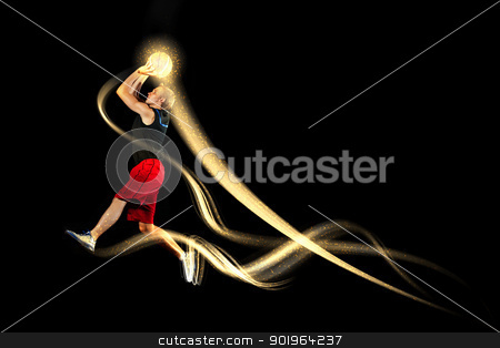 Basketball player with a ball stock photo, Male basketball player jumping and practicing with a ball by Sergey Nivens