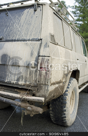 Needs a wash stock photo, Old very dirty off-road car with mud and dirt. by Stocksnapper