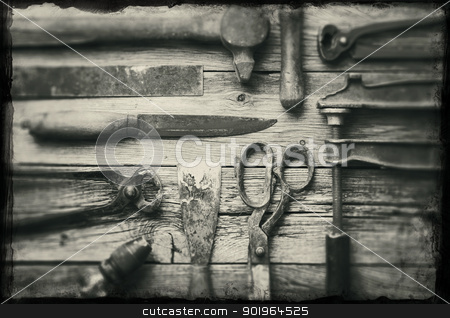 Old tools stock photo, A collection of old rusty tools with grunge borders. by Stocksnapper 