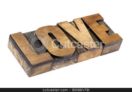 love word in wood type stock photo, love word - isolated text in vintage letterpress wood type printing blocks by Marek Uliasz