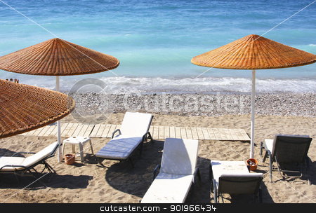 Beach chairs and umbrellas  stock photo, Beach chairs and umbrellas on a beach by Georgios Kollidas