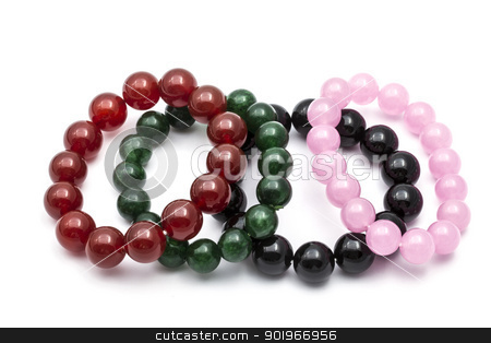 Colorful Bead Bracelets stock photo, Colorful bead bracelets isolated on white background by Ingvar Bjork