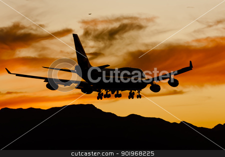 Aircraft Landing At Sunset stock photo, Commercial aircraft land at an airport at sunset by Walter Arce