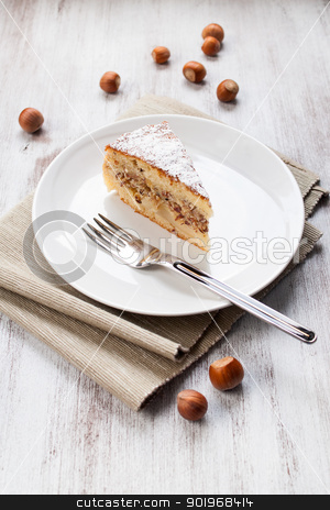 Cake to the nuts stock photo, Slice of cake to the nuts on dish by Giordano Aita
