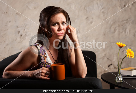 Worried Woman with Cup stock photo, Worried woman holding coffee mug and puckering her lips by Scott Griessel