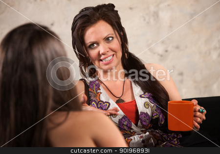 Lady Talking to Her Friend stock photo, Pretty lady with ceramic cup talking with a friend by Scott Griessel