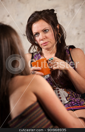 Concerned Woman Listening to Friend stock photo, Concerned Caucasian brunette female listening to a friend by Scott Griessel