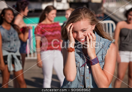 Shy Giggling Girl at Park stock photo, Shy giggling teenage girl covering her face at carnival by Scott Griessel