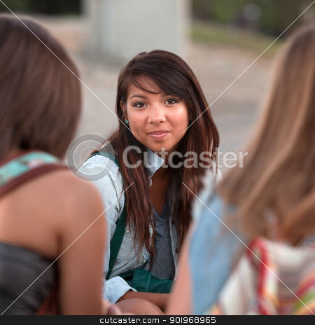 Young Girl with Calm Smile stock photo, Calm young Native American teenager between two friends by Scott Griessel