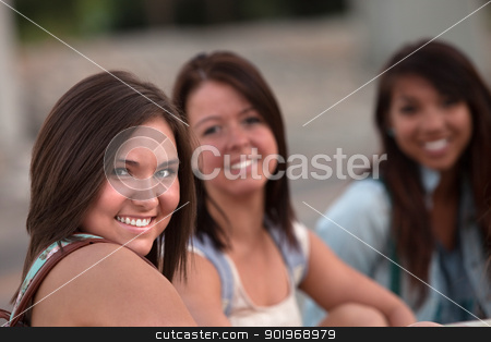 Three Cute Teen Girls Sitting stock photo, Group of three Asian and European teenage girls sitting by Scott Griessel