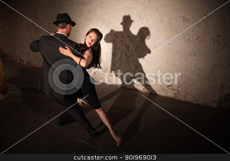 Pretty Tango Dancer with Partner stock photo, Beautiful woman with dance partner performing a tango routine by Scott Griessel