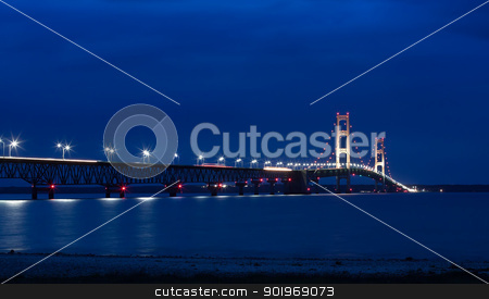 Mackinac Bridge at Night stock photo, The Mackinac Bridge is located on Interstate 75 in northern Michigan at the Straits of Mackinac. The bridge connects Michigan's upper and lower peninsulas.