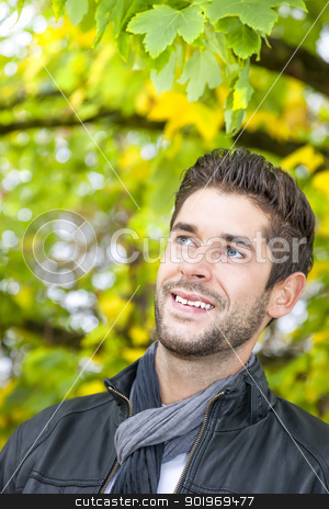 young man in the autumn stock photo, An image of a handsome young man in the autumn by Markus Gann
