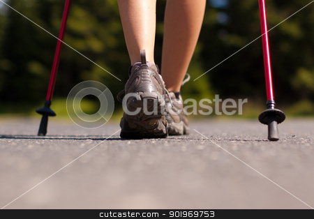 Nordic walking in summer stock photo, Closeup of woman legs' with nordic walking poles by kamsta