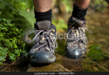 Hicking shoes in outdoor action stock photo, Closeup of hiking shoes with a stream in the background by kamsta
