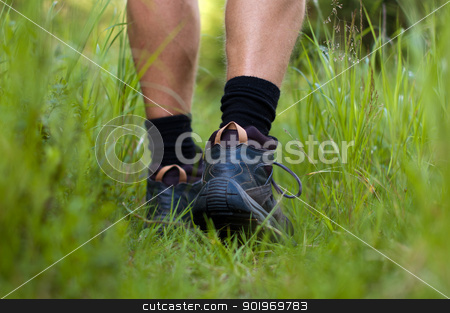 Hicking shoes in outdoor action stock photo, Closeup of hiking shoes in a grass by kamsta