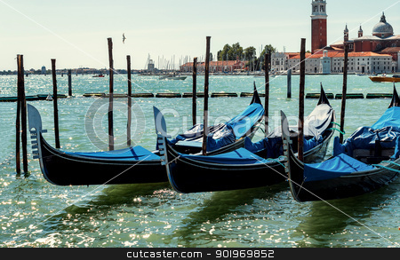 gondolas in Venice, Italy Grand canal  stock photo, empty blue gondolas in lagoon Venice Italy by Artush