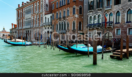 gondolas in lagoon Venice Italy Grand canal  stock photo, empty blue gondolas in lagoon Venice Italy by Artush