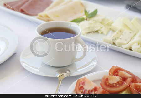 A cup of tea on breakfast table stock photo, Breakfast table with cheese and tomatoes by necati turker