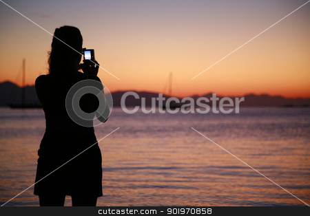 Girl is taking picture of beatiful sunset stock photo, Sunset in Datca with sailboats by necati turker