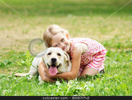 little girl with her dog stock photo, A little blond girl with her pet dog outdooors in park by Sergey Nivens
