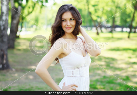 Young woman outdoor stock photo, Beautiful young woman in the park. Outdoor portrait by Sergey Nivens