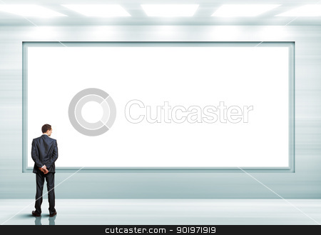 Business person standing near a blank billboard stock photo, Business person standing near a white blank  billboard by Sergey Nivens