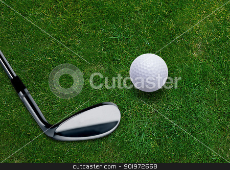 Golf ball  stock photo, Golf ball and golf putter on green grass land .  by Designsstock