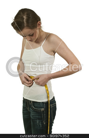 Woman Measuring Her Waist stock photo, Beautiful woman measuring her waist with a tailors tape by Robert Byron