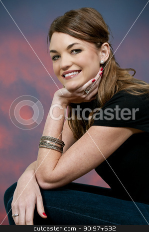 Beautiful Woman Sitting stock photo, Beautiful young woman sitting down and smiling by Robert Byron