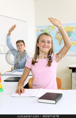 Students raising their hands in class stock photo, Photo of two students in their class raising their hands to answer a question.  by © Ron Sumners