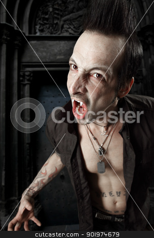 Blood sucking vampire stock photo, Photo of a male vampire with mouth open and fangs showing.  Harsh lighting and heavily filtered for scarier feel. by © Ron Sumners