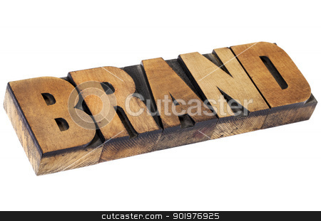 brand in letterpress wood type stock photo, brand - isolated word in vintage letterpress wood type, selective focus by Marek Uliasz