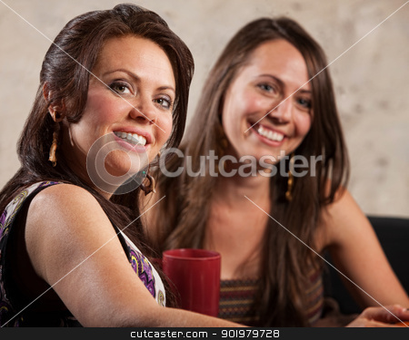 Two Beautiful Women Sitting Together stock photo, Two beautiful Caucasian brunette females sitting indoors by Scott Griessel
