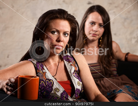 Worried Women Sitting stock photo, Serious pair of Caucasian brunette females sitting together by Scott Griessel