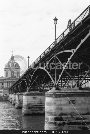 Woman on Pont des Artes, Paris stock photo, Low angle black and white image of a woman standing on the Pont des Artes, Paris, a pedestrian bridge over the Seine by pcooklin