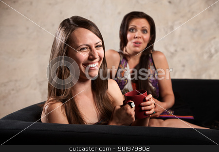 Pretty Women Laughing Together stock photo, Pretty Caucasian females on sofa laughing together by Scott Griessel