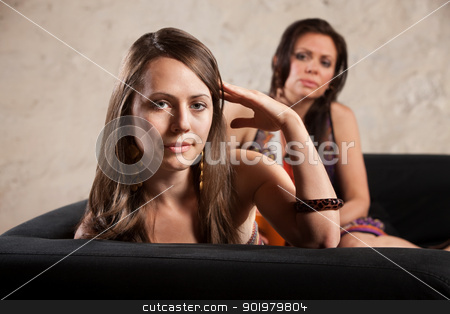 Woman Turns Away From Person stock photo, Annoyed woman turns her head away from lady on sofa by Scott Griessel