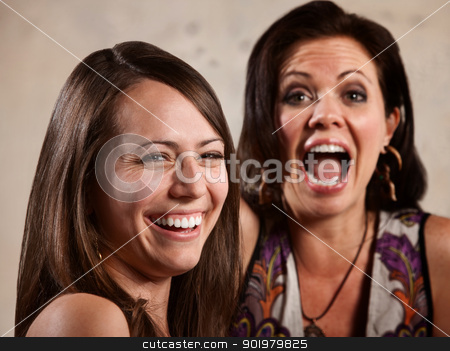 Pair of Ladies Laughing stock photo, Pair of beautiful Caucasian brunette women laughing by Scott Griessel