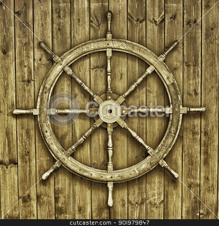 Decorative wooden ships wheel stock photo, Nautical backdrop of a decorative wooden ships wheel mounted on a wooden facade at Knaresborough, England by Joshua Hilton