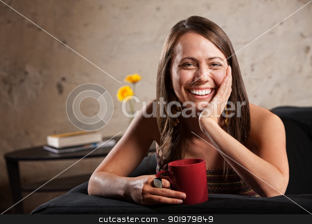 Pretty Woman with Big Smile stock photo, Happy woman with long hair sitting on sofa with mug by Scott Griessel