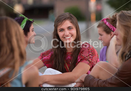 Confident Female Teenager stock photo, Confident Caucasian teenage girl with group of friends by Scott Griessel