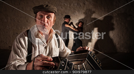 Handsome Musician and Dancers stock photo, Bandoneon player singling with dancers in background by Scott Griessel