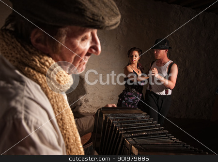 Dancers with Squeezebox Performer stock photo, Two European tango dancers turning as squeezebox performer plays by Scott Griessel