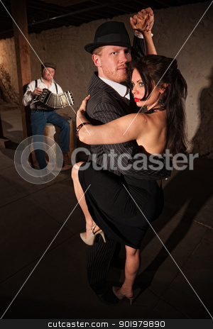 Woman and Man in Tango Dance stock photo, Lovely woman in black with male dancing partner performing tango by Scott Griessel