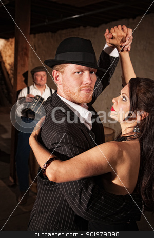 Handsome Tango Dancer with Partner stock photo, Handsome Tango dancer in pinstripe suit with sexy partner by Scott Griessel