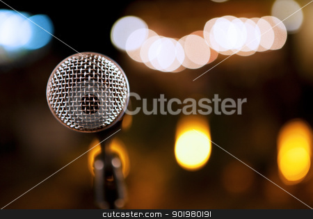Microphone detail background stock photo, Close-up image of microphone on stage by carloscastilla